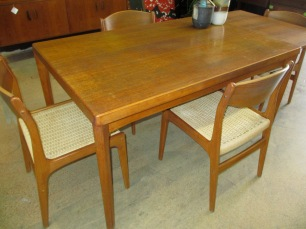 VEJLE STOLE teak dining table with two enclosed leaves and four paper rope chairs. $895.