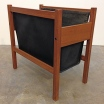 Vintage teak and black leather magazine rack, 3/4 view.