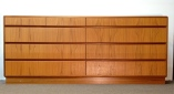 "HOLMEGAARD 9-drawer teak platform-base dresser, front view, excellent condition, 30H x 72""W x 19""D."
