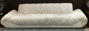 Vintage 70's, pieced faux fur gondola-style sofa. About 9' length...