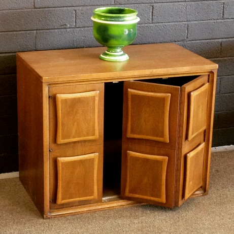 TV/storage cabinet, mixed walnuts, folding door, excellent condition.