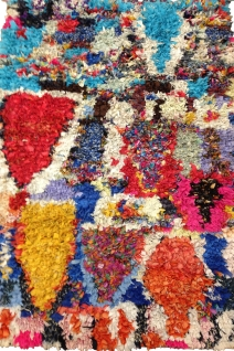 """Vintage Boucherite """"rag"""" textile. Heavy enough for a floor covering. Woven of colorful scraps in an abstract and highly colorful pattern."""