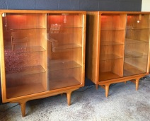 Vintage sliding glass door with eight each removable glass shelves,